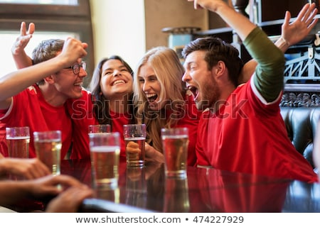 Hanging on sports bar Stock photo © pressmaster