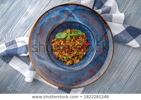 delicious seafood risotto and greek salad stock photo © karandaev