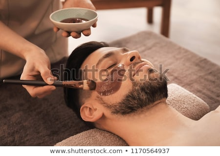 Chocolate Body Spa, Beautician and Client on Table Stock photo © robuart