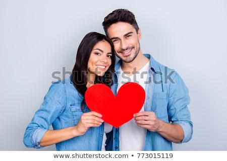 man holding red heart over grey background Stock photo © dolgachov