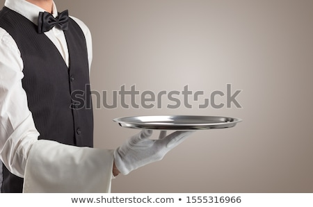 Waiter serving with white gloves and steel tray Stock photo © ra2studio