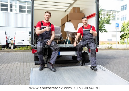 Male Mover Sitting In Van Showing Thumb Up Sign Stock photo © AndreyPopov