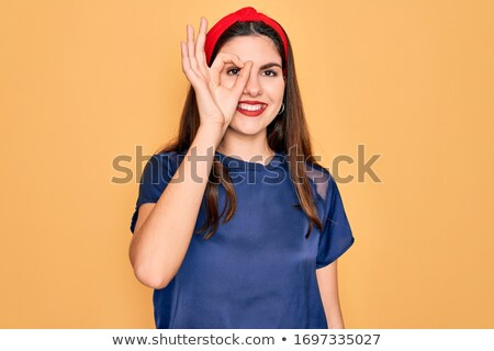 red haired teenage girl looking through fingers Stock photo © dolgachov