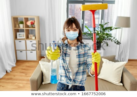 asian woman with mop and detergent cleaning home Stock photo © dolgachov