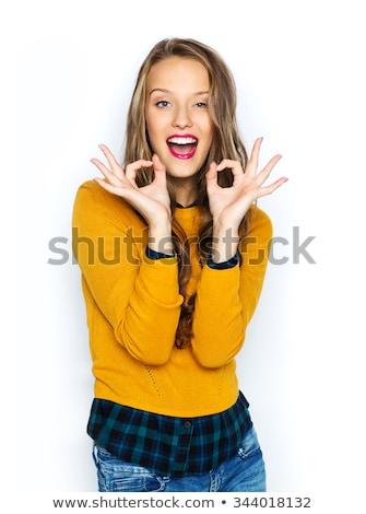 Foto stock: Lovely Teenage Girl Showing Ok Sign