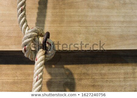 Big navy rope on wooden plank  Stock photo © sasilsolutions