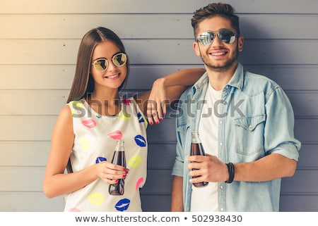 Beautiful girl holding out bottled water to camera Stock photo © darrinhenry