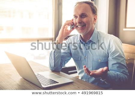 altos · mujer · de · negocios · teléfono · sonriendo · hablar - foto stock © nyul