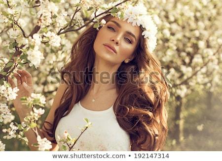 Kadın elma çiçek saç güzel bir kadın seksi Stok fotoğraf © pekour