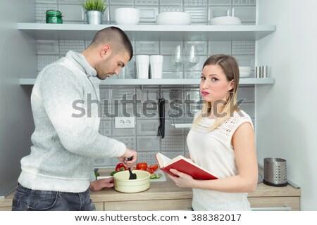 Jeune homme jeunes souriant lecture livre de cuisine famille Photo stock © photography33