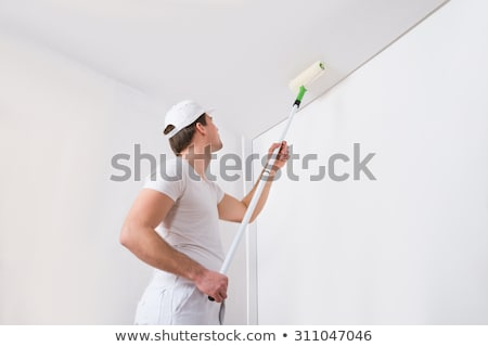 decorator painting a ceiling white stock photo © photography33