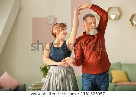Happy aged couple enjoying music together Stock photo © stockyimages