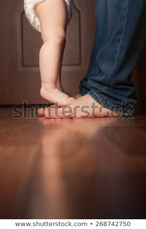 Baby feet and denim Stock photo © pictureguy