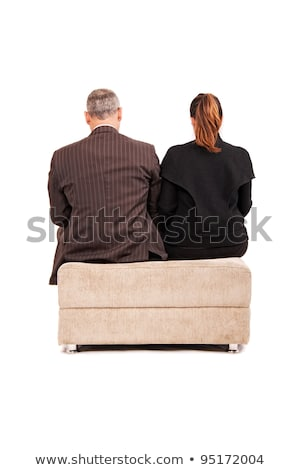 Couple sat back to back on sofa Stock photo © photography33