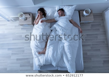 Young woman and man lying in white bed stock photo © CandyboxPhoto