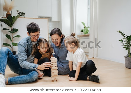 Father and daughter building a tower of blocks Stock photo © photography33
