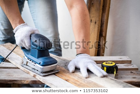 Worker with an electric sander Stock photo © photography33