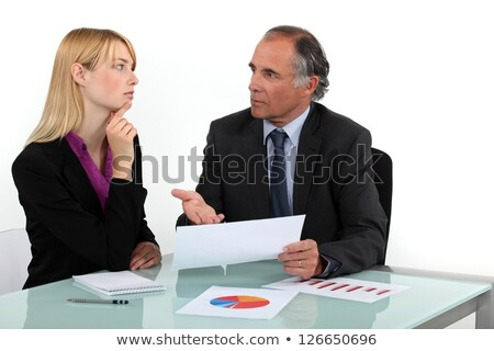 Businesspeople going over statistical data Stock photo © photography33