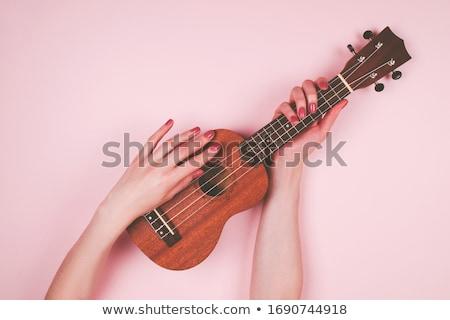 Girl holding guitar Stock photo © photography33