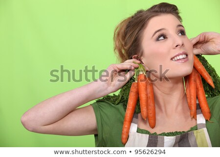 a female cook wearing carrots as earrings Stock photo © photography33