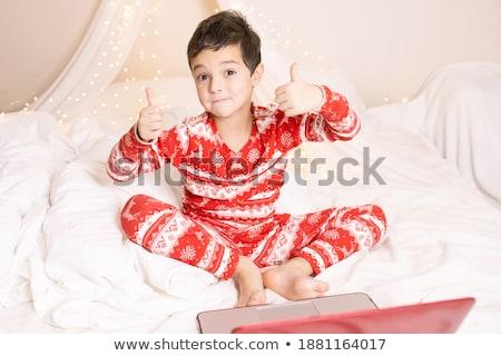 Portrait of cute caucasian boy smiling with laptop stock photo © get4net
