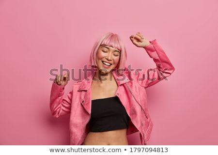 dancing pink hair girl Stock photo © dolgachov
