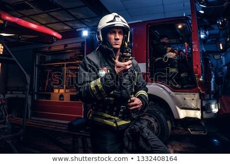 Servicios de emergencia fuego hombres traje servicio gas Foto stock © david010167