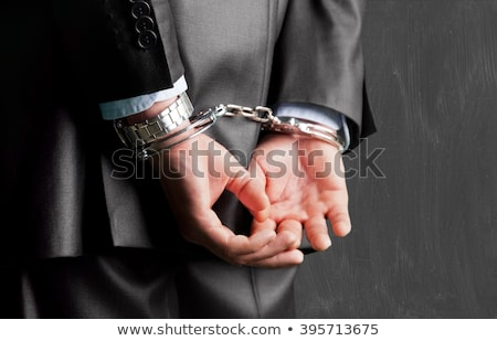 Rear view of businessman with handcuffs Stock photo © wavebreak_media