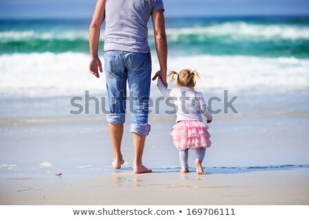 Foto stock: Father And His Little Daughter At Beach