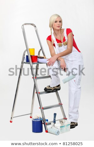 Decorator with a roller and cans of primary colored paint Stock photo © photography33