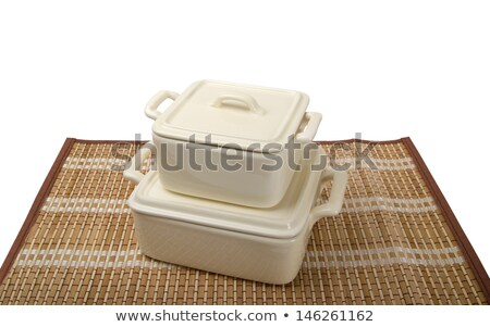 Two white ceramic pots for stove on bamboo mat Stock photo © BSANI