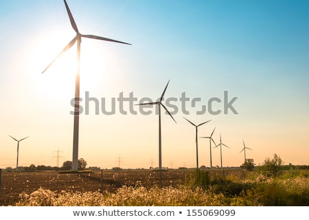Wind mills during bright summer day Stock photo © Elnur
