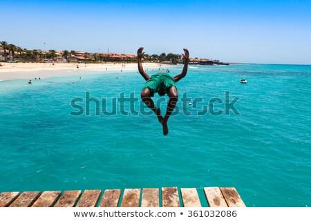boy in the ocean swims in beautiful clear water Stock photo © meinzahn