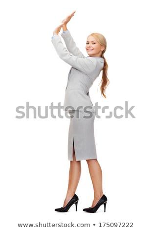 Femme d'affaires poussant up quelque chose imaginaire affaires Photo stock © dolgachov