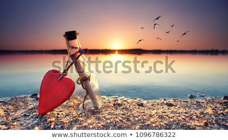 bottle with hearts stock photo © shawlinmohd
