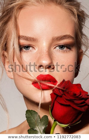Amusing beautiful blond with roses
