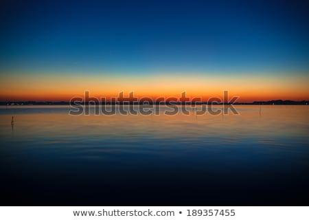 Azul naranja puesta de sol lago luz verano Foto stock © shihina