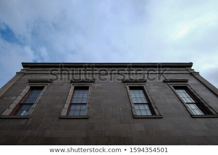 Brick wall buildings on a cloudy day Stock photo © gemenacom