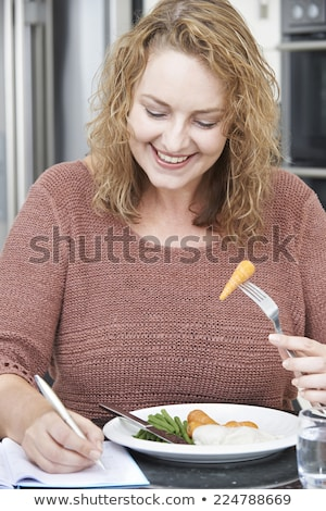 Woman On Diet Writing Details In Food Journal Stock photo © HighwayStarz