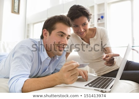 Couple at the Couch with Laptop, Card and Money Stock photo © juniart