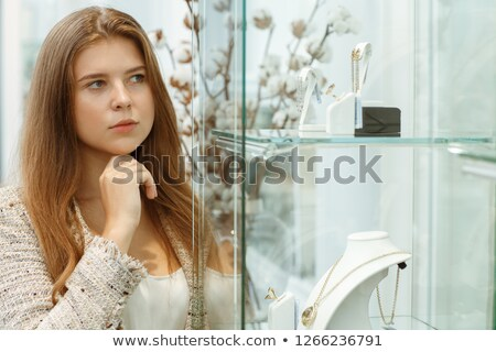 young thinking female with shiny earrings stock photo © gromovataya