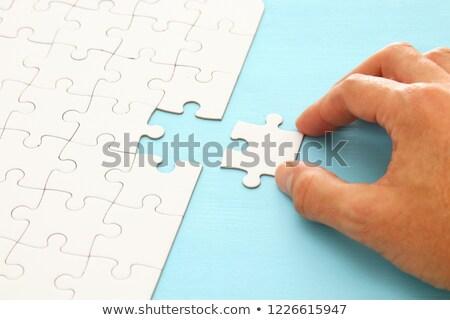Férfi kéz hiányzó darab kirakós játék fehér Stock fotó © stevanovicigor