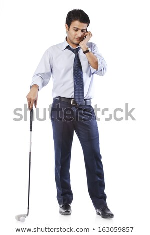 Businessman holding a golf club and talking on cell phone Stock photo © imagedb