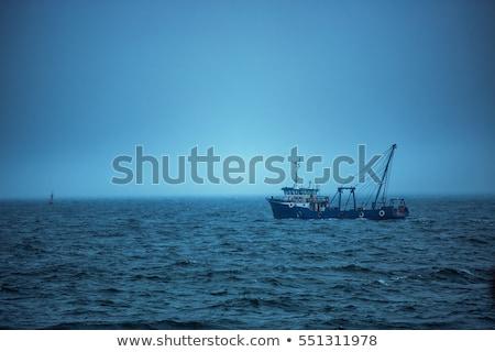 Balıkçı tekne yelkencilik sabah buğu Stok fotoğraf © AlisLuch