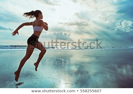 young woman runs along the edge of the sea stock photo © Paha_L