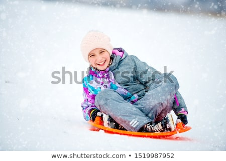 children  sits on plastic sled in park in winter Stock photo © Paha_L
