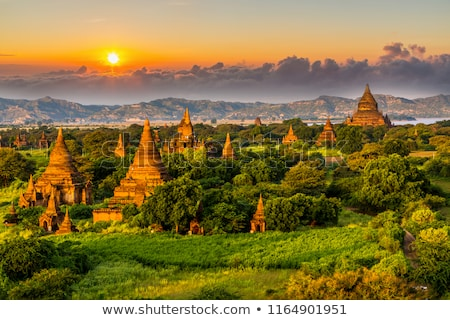 Pagode paisagem crepúsculo quente pôr do sol Mianmar Foto stock © smithore