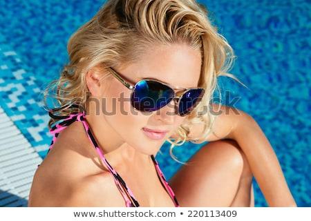 Közelkép nő napozás társalgó tengerpart nyári vakáció Stock fotó © dolgachov
