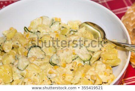 delicious potato salad with cocumber and cream stock photo © meinzahn