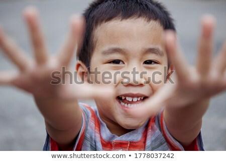 Bonitinho menino sorridente olhando isolado Foto stock © alexandrenunes